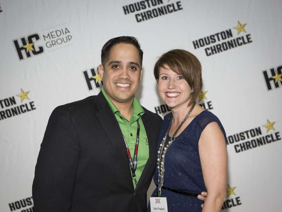 Michael Losoya, left, and Jada England attend the Houston Auto Show's 30th Anniversary Preview Party Tuesday, Jan. 21, 2014, in Houston. ( Nick de la Torre