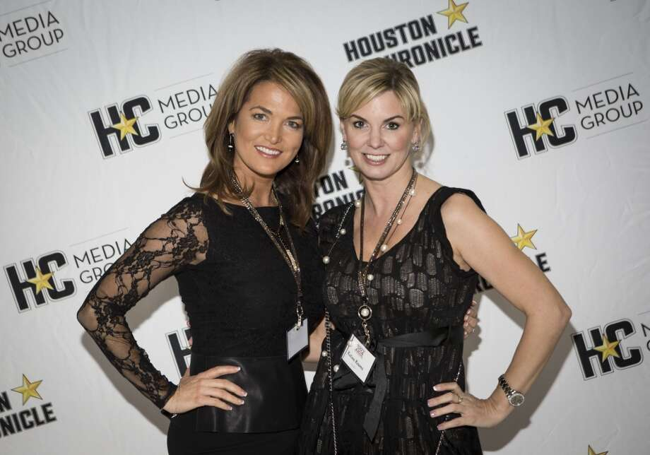 Katina Kearns, left, and Melissa Wilson attend the Houston Auto Show's 30th Anniversary Preview Party Tuesday, Jan. 21, 2014, in Houston. ( Nick de la Torre