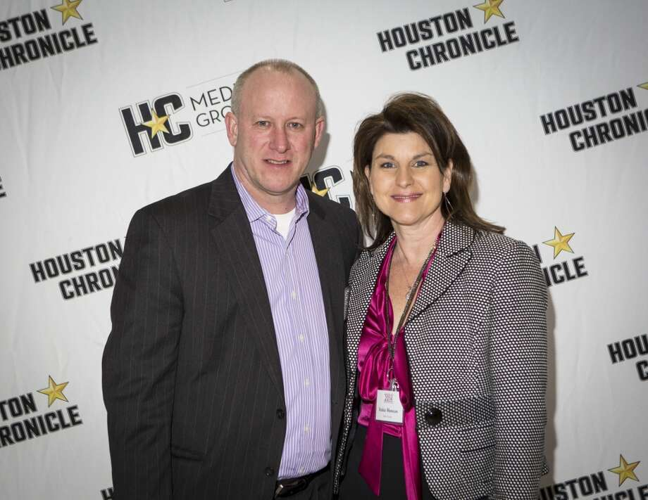 Tim Moncure, left, and Vickie Moncure attend the Houston Auto Show's 30th Anniversary Preview Party Tuesday, Jan. 21, 2014, in Houston. ( Nick de la Torre