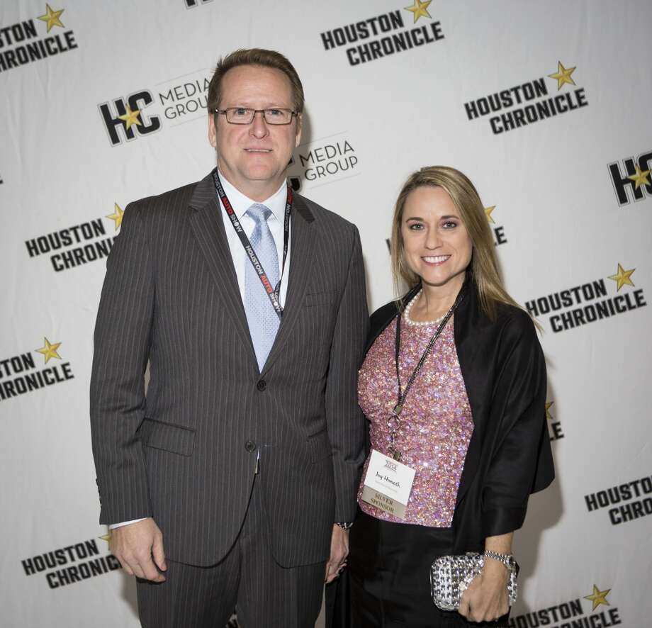Steven Horvath, left, and Joy Horvath attend the Houston Auto Show's 30th Anniversary Preview Party Tuesday, Jan. 21, 2014, in Houston. ( Nick de la Torre