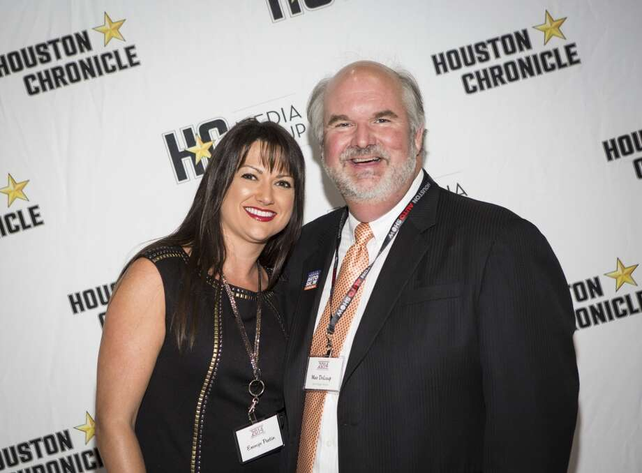Emmye Partin, left, and Mac De Laup attend the Houston Auto Show's 30th Anniversary Preview Party Tuesday, Jan. 21, 2014, in Houston. ( Nick de la Torre