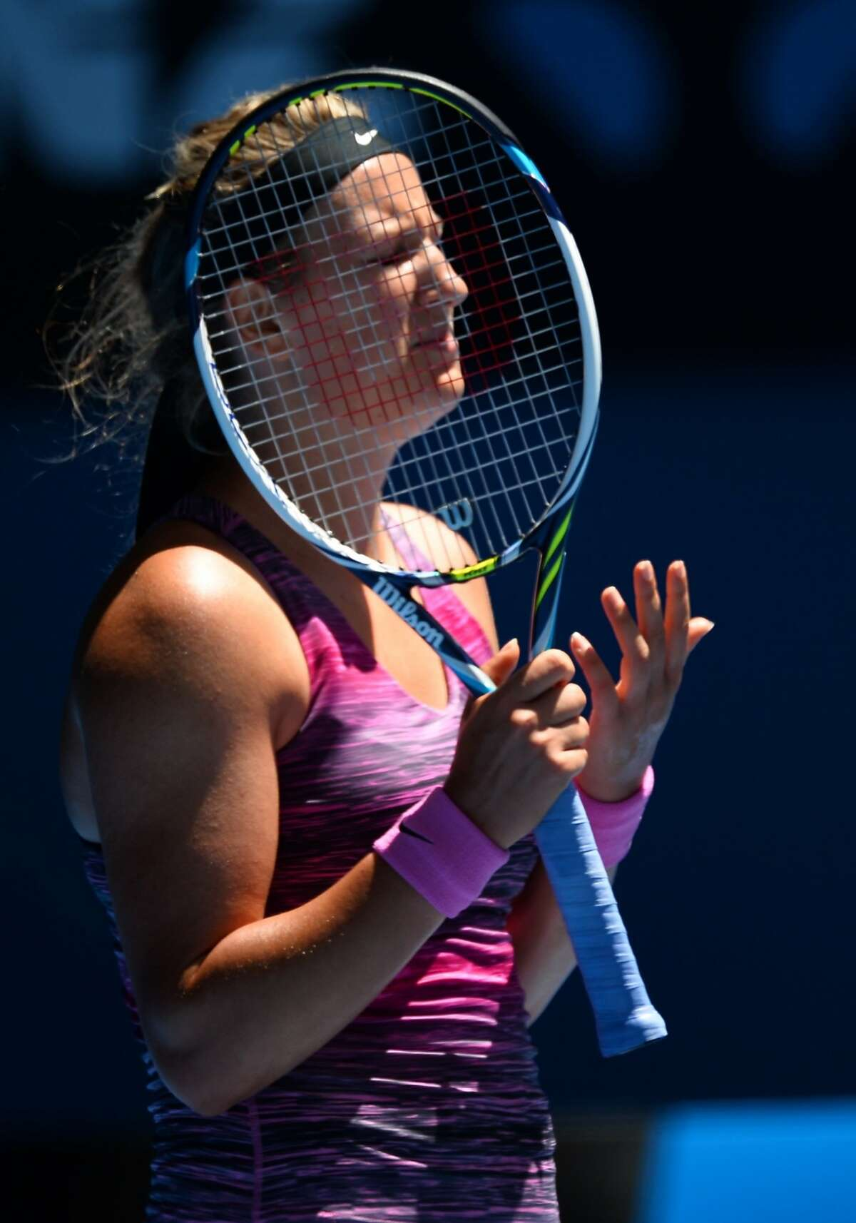 Victoria Azarenka of Belarus reacts during her women's singles match against Agnieszka Radwanska of Poland on day 10 of the 2014 Australian Open tennis tournament in Melbourne on January 22, 2014. IMAGE RESTRICTED TO EDITORIAL USE - STRICTLY NO COMMERCIAL USE AFP PHOTO / WILLIAM WESTWILLIAM WEST/AFP/Getty Images