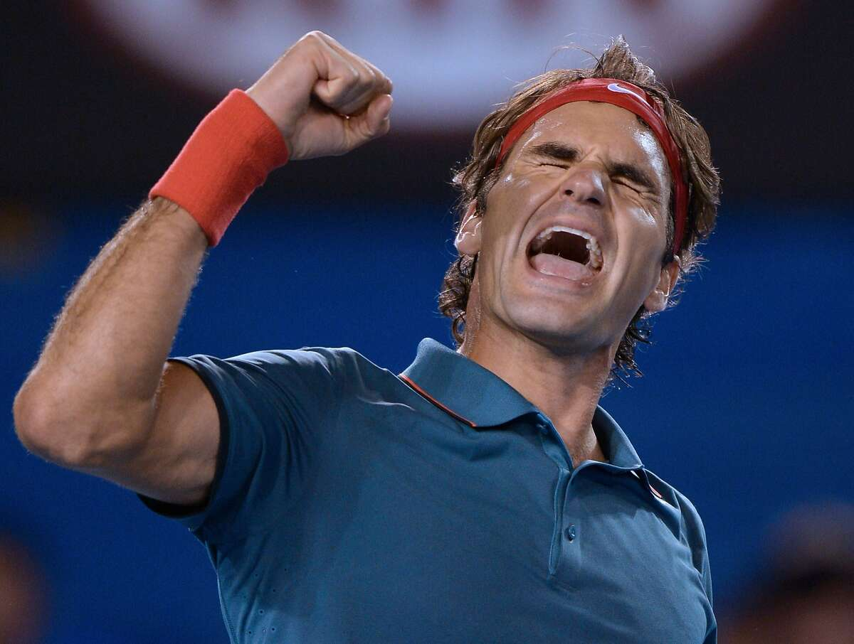 TOPSHOTS Switzerland's Roger Federer celebrates after victory in his men's singles match against Britain's Andy Murray on day ten of the 2014 Australian Open tennis tournament in Melbourne on January 22, 2014. IMAGE RESTRICTED TO EDITORIAL USE - STRICTLY NO COMMERCIAL USE AFP PHOTO / GREG WOODGREG WOOD/AFP/Getty Images