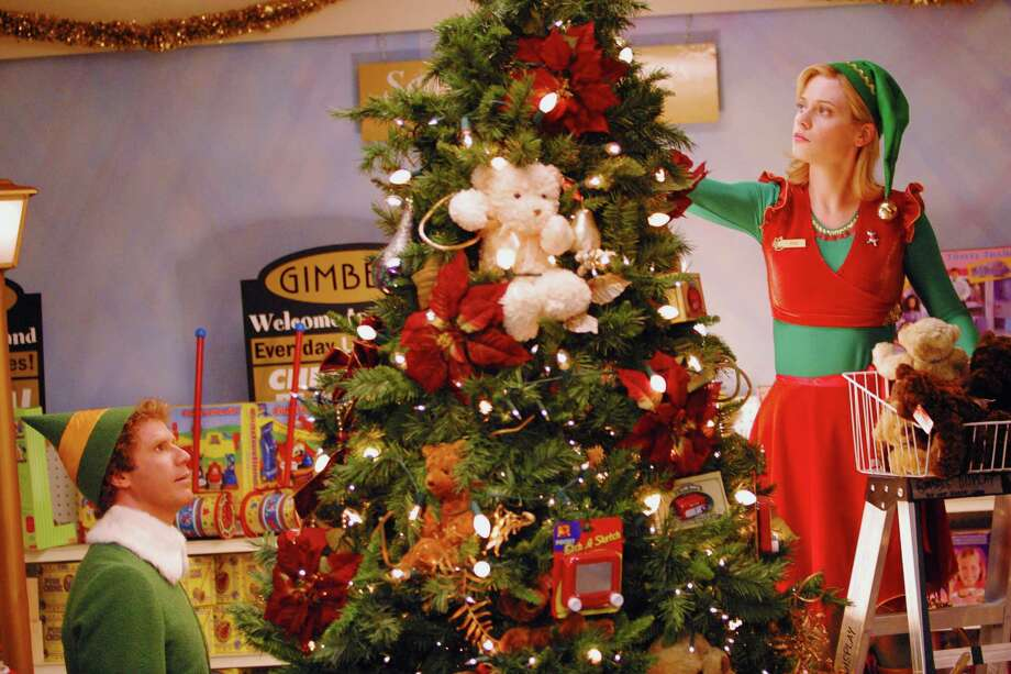 """You have such a pretty face, you should be on a Christmas card!""— Buddy the elf to Deb in ""Elf."" PHOTO: Buddy (Will Ferrell) helps Jovie (Zooey Deschanel) decorate a tree in this scene from ""Elf."" Photo: Courtesy Photo/New Line Cinema"