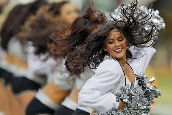 The Raiderettes entertain the crowd during  a timeout in the third quarter. The Oakland Raiders played the Philadelphia Eagles at O.co Coliseum in Oakland, Calif., on Sunday, November 3, 2013.