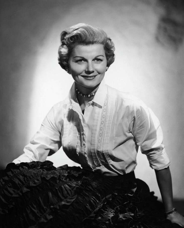 """Eddie Haskell: Gee, your kitchen always looks so clean.  June Cleaver: Why, thank you, Eddie.  Eddie Haskell: My mother says it looks as though you never do any work in here.— Eddie to June on """"Leave It To Beaver."""" PHOTO: Studio portrait of June (Barbara Billingsley) in """"Leave It To Beaver,"""" circa 1955. Photo: CBS Photo Archive, Getty Images / Archive Photos"""