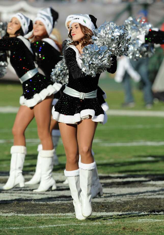Oakland Raiders cheerleader Lacy T., seen in 2013, was a plaintiff in a lawsuit accusing the team of violating wage laws. Photo: John Cordes / Associated Press / FR170993 AP