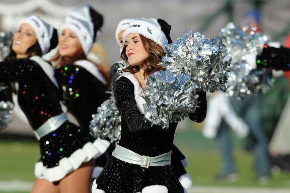 Oakland Raiders cheerleader Lacy T., seen in 2013, was a plaintiff in a lawsuit accusing the team of violating wage laws.