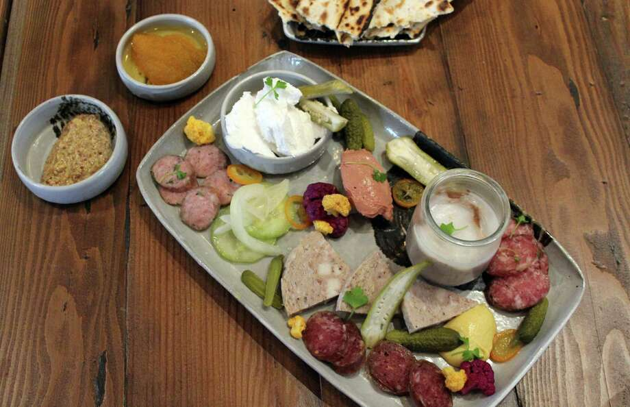 Cured features a daily selection of a dozen or so charcuterie options house-cured for at least 60 days. Guests of Cured, located in the restored administration building at the Pearl, can select three, six or nine items for $18 to $34. Photo: Jennifer McInnis / San Antonio Express-News