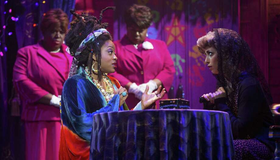 Carla R. Stewart (seated, left, with cast members Nicole Turner, from left, Evette Maria White and Hana Freeman) is the medium Oda Mae. The musical based on the popular movie is at Majestic Theatre through Sunday. Photo: Courtesy Photos