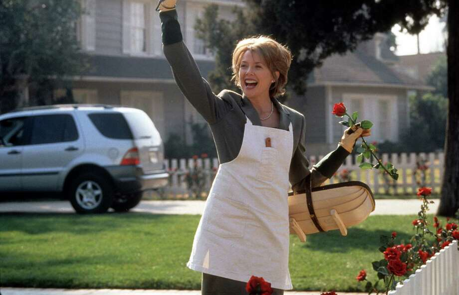 """Honey, I'm so proud of you. I watched you very closely, and you didn't screw up once!""— Carolyn Burnham in ""American Beauty.""PHOTO: Carolyn (Annette Bening) standing in a yard waiving with one hand and holding a rose in the other in a scene from the film ""American Beauty,"" 1999. Photo: Hulton Archive, Getty Images / 2013 Getty Images"