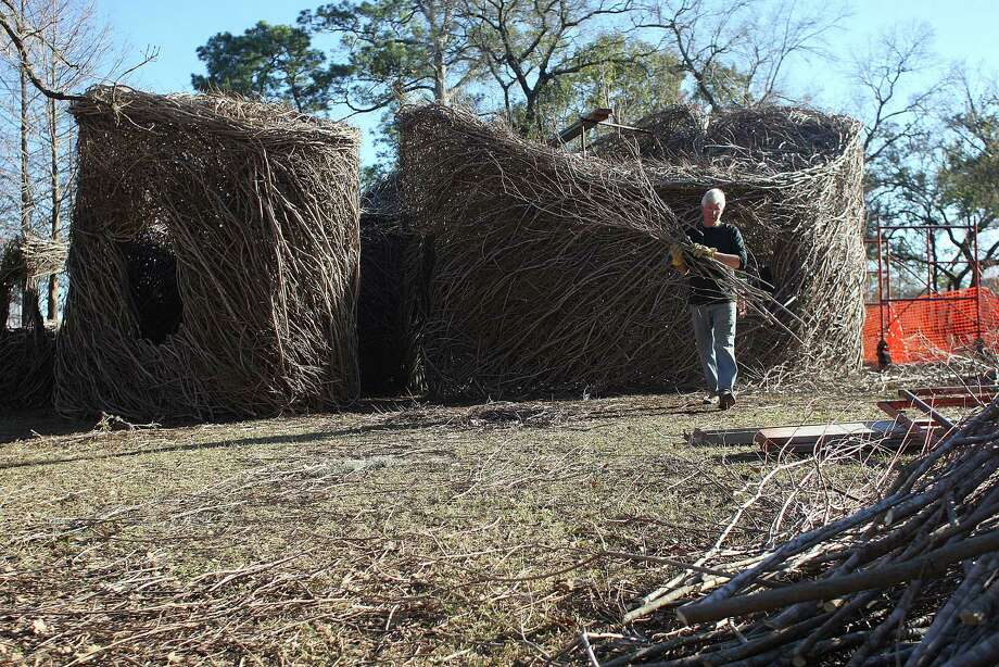 "Artist Patrick Dougherty moves sticks from his ""stick work"" sculpture at Hermann Park Tuesday, Jan. 21, 2014, in Houston. ( Johnny Hanson / Houston Chronicle ) Photo: Johnny Hanson, Staff / © 2014  Houston Chronicle"