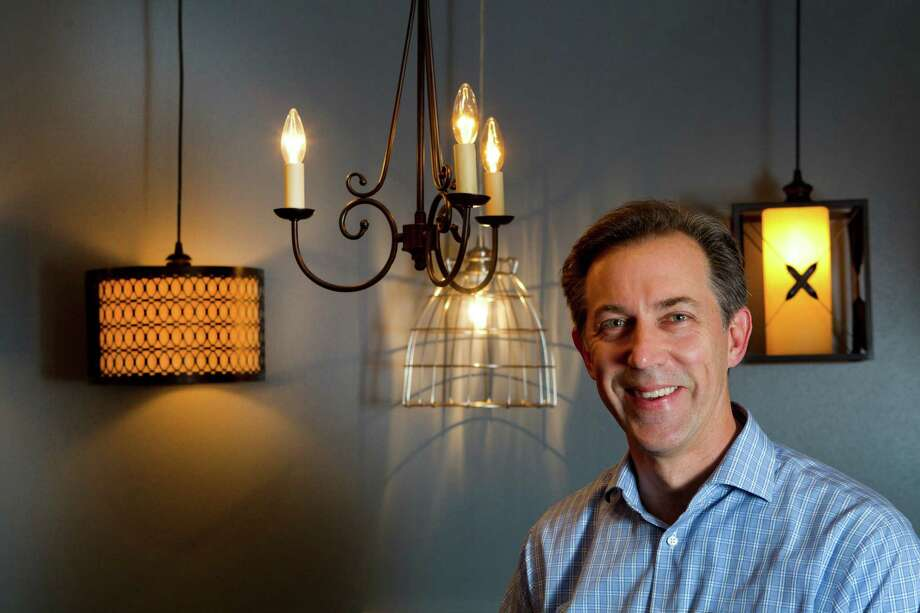 Steve Machiorlette of Worth Products Group invented Instant Pendant Lights. Photo: Brett Coomer, Staff / © 2013 Houston Chronicle