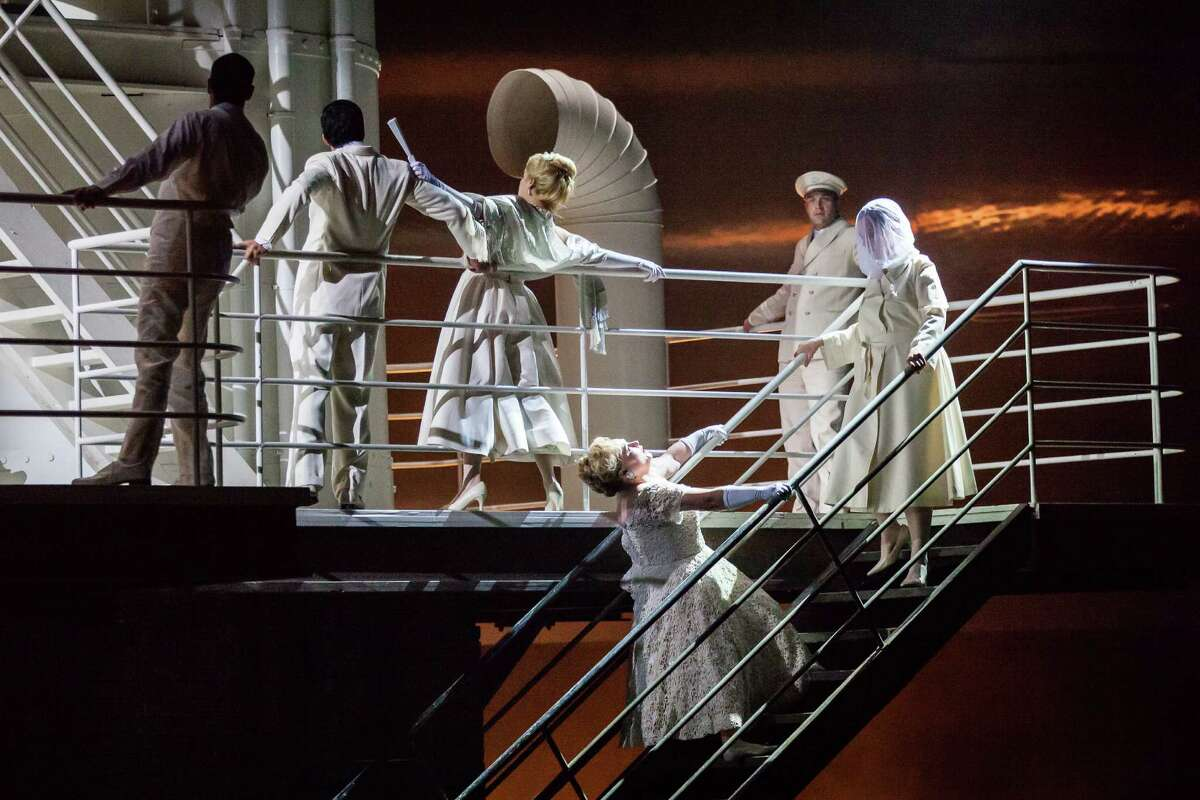 """Michelle Breedt, leaning backward on stairs, plays Liese, a former concentration-camp overseer, in Houston Grand Opera's production of Mieczyslaw Weinberg's """"The Passenger."""""""