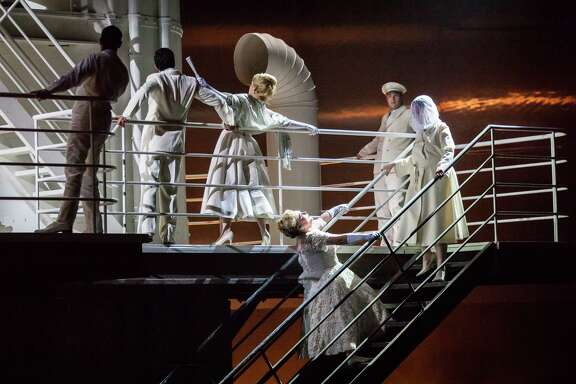 "Michelle Breedt, leaning backward on stairs, plays Liese, a former concentration-camp overseer, in Houston Grand Opera's production of Mieczyslaw Weinberg's ""The Passenger."""