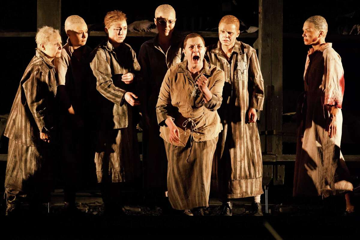 """Melody Moore, center, plays Marta, a prisoner in a concentration camp, in Houston Grand Opera's production of Mieczyslaw Weinberg's """"The Passenger."""""""