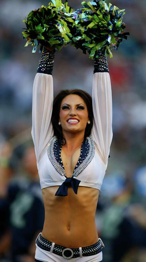 A Seattle Seahawks Sea Gals cheerleader performs Aug. 17, 2013. Photo: Otto Greule Jr, Getty Images / 2013 Getty Images