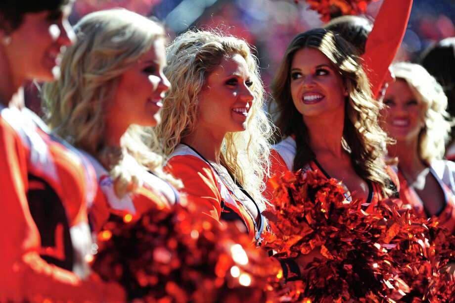 Members of the Denver Broncos Cheerleaders perform Oct. 27, 2013. Photo: Scott Cunningham, Getty Images / 2013 Scott Cunningham
