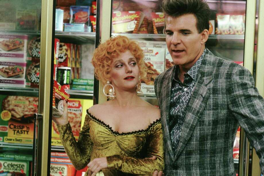 """Vincent 'Vinnie' Antonelli: You know, it's dangerous for you to be here in the frozen food section.  Shaldeen: Why is that? Vincent 'Vinnie' Antonelli: Because you could melt all this stuff. — Vinnie to Shaldeen in """"My Blue Heaven.""""PHOTO:  Shaldeen (Carol Kane) and Vincent (Steve Martin) standing in front of supermarket freezer in """"My Blue Heaven."""" Photo: Andrew Cooper, Getty Images / (C) Warner Bros. Entertainment Inc."""