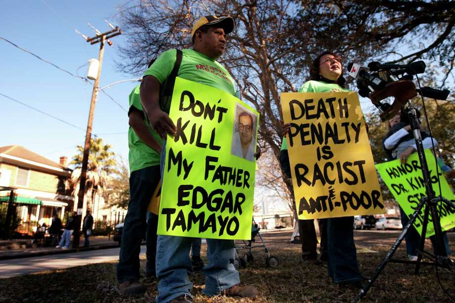 Benjamin Ramirez, left, watches as Martina Grifaldo with Alianza Mexicana, right, speaks during a news conference outside of the Mexican Consulate regarding the execution of Edgar Tamayo, Wednesday, Jan. 22, 2014, in Houston. Attorneys for the Mexican national on Texas death row considered additional appeals to block his impending execution for the slaying of a Houston police officer after a federal judge Tuesday rejected their request for an injunction to contest a clemency process they argued was unfair and secretive. His execution is scheduled for this evening in Huntsville, Tx. Photo: Cody Duty, Houston Chronicle / © 2014 Houston Chronicle