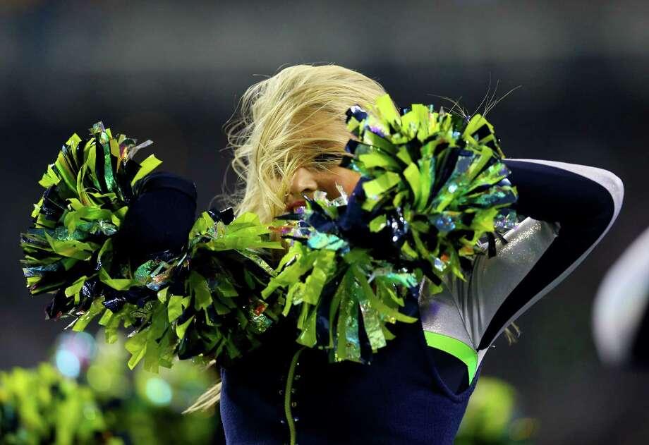 Seattle Seahawks Sea Gals perform Jan. 19, 2014. Photo: Ronald Martinez, Getty Images / 2014 Getty Images