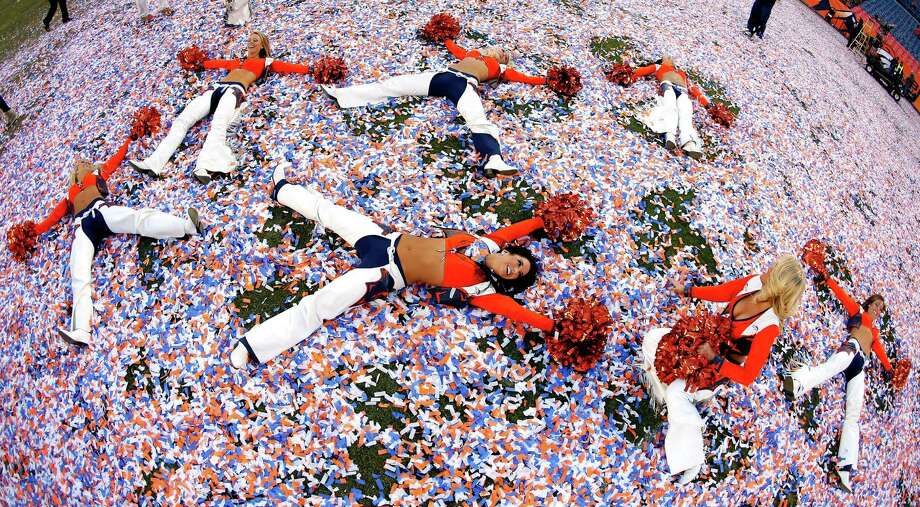 Denver Broncos cheerleader celebrates after the AFC Championship game  between the New England Patriots and the Denver Broncos on Jan. 19,  2014. Photo: Kevin C. Cox, Getty Images / 2014 Getty Images