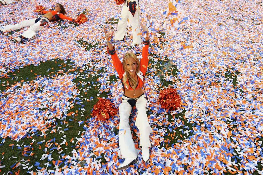 Denver Broncos cheerleader celebrates after the AFC Championship game 
