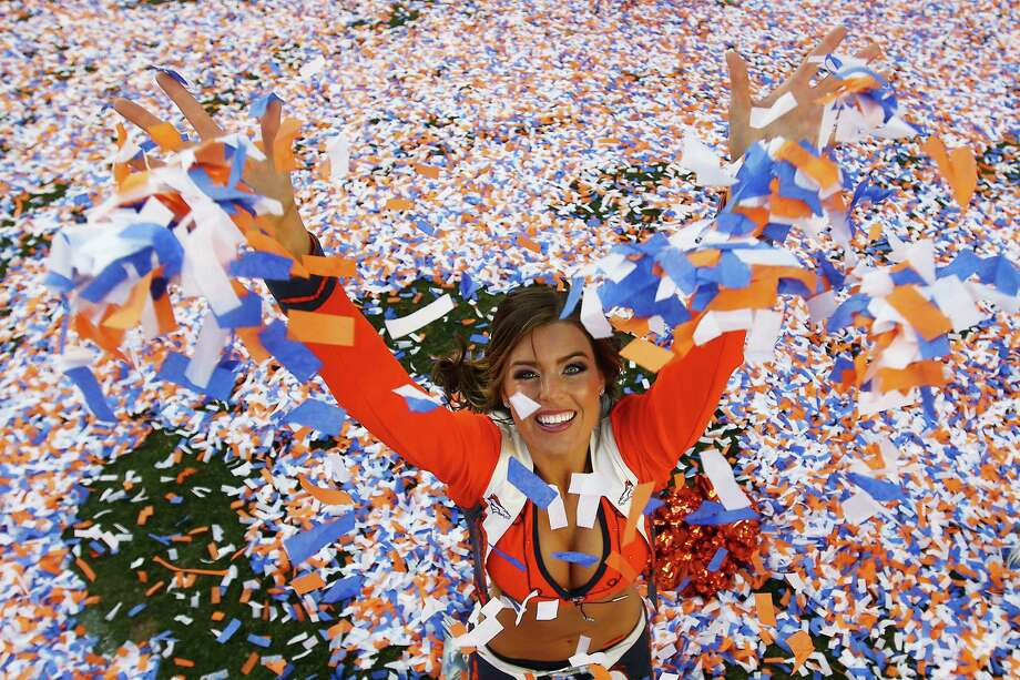 Denver Broncos cheerleader celebrates after the AFC Championship game between the New England Patriots and the Denver Broncos on Jan. 19, 2014. Photo: Doug Pensinger, Getty Images / 2014 Getty Images
