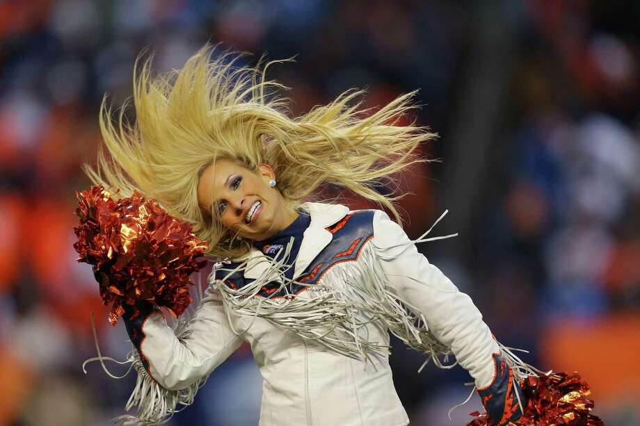 A Denver Broncos cheerleader performs Jan. 12, 2014. Photo: Justin Edmonds, Getty Images / 2014 Getty Images