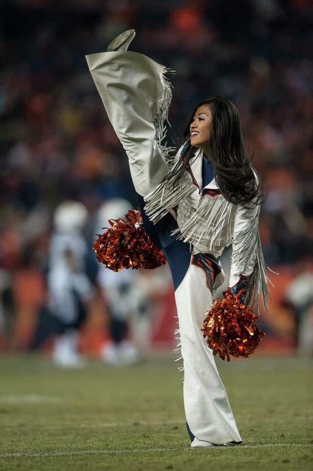 A Denver Broncos cheerleader performs Dec. 12, 2013. Photo: Dustin Bradford, Getty Images / 2013 Getty Images