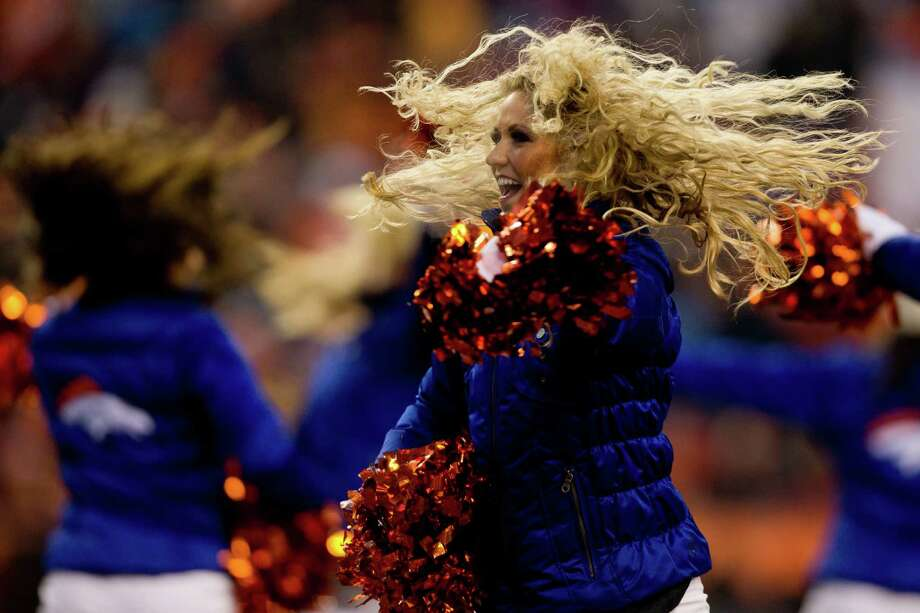 A Denver Broncos cheerleader performs Dec. 8, 2013. Photo: Justin Edmonds, Getty Images / 2013 Getty Images