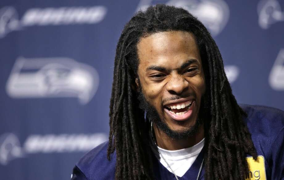 Seattle Seahawks' Richard Sherman laughs as he speaks during a news conference Wednesday, Jan. 22, 2014, in Renton, Wash. The Seahawks play the Denver Broncos in the NFL football Super Bowl on Feb. 2. (AP Photo/Elaine Thompson) Photo: Associated Press