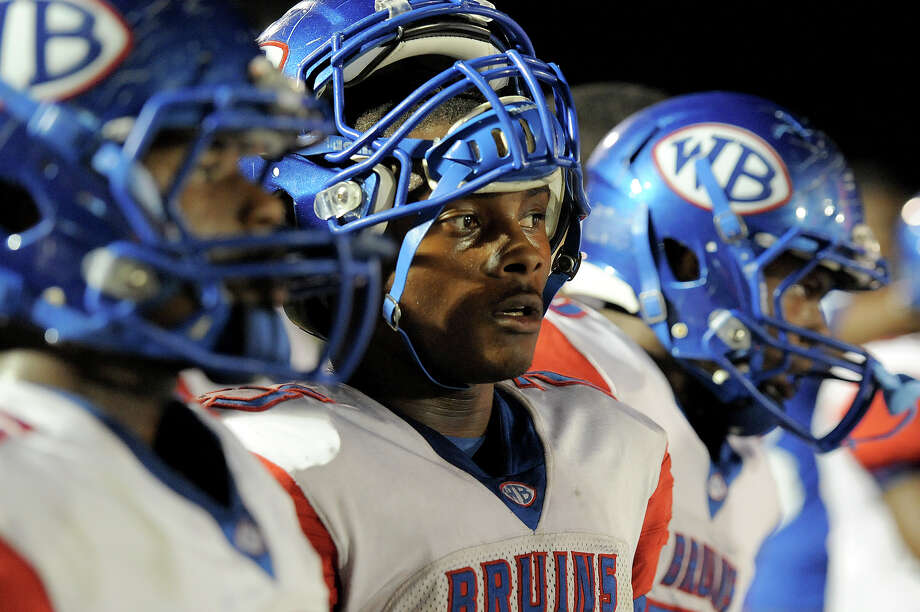 West Brook's Justin Hervey, 25, watches a play during a short break against Port Arthur Memorial from the sideline at Memorial High School Stadium. Photo by Drew Loker. Photo: Drew Loker / ©2013. www.drewloker.com