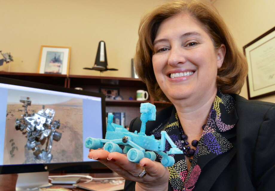 "Laurie A. Leshin, dean of the School of Science, holds a scale model of the Mars Rover ""Curiosity,"" 3D printed for her by an RPI grad student at her office on the RPI campus Tuesday Jan. 8, 2012. The NASA spacecraft is currently exploring the surface of Mars. (John Carl D'Annibale / Times Union)"