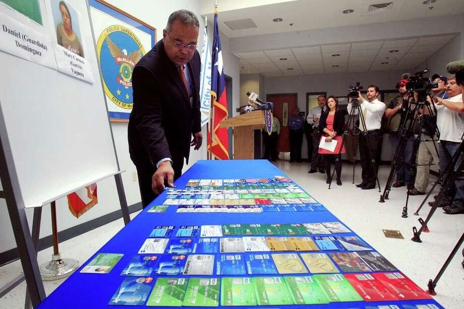 ADDS RECENT DEVELOPMENT-McAllen Police Chief Victor Rodriguez displays dozens of fraudulent credit cards that were confiscated by McAllen police after arresting a man and a woman on fraud charges tied to the December Target credit card breach, Monday Jan. 20, 2014 at the McAllen Police Department in McAllen, Texas. Rodriguez said Mary Carmen Garcia, 27, and Daniel Guardiola Dominguez, 28, both of Monterrey, Mexico, were arrested Sunday, Jan. 19, 2014 after arriving at the border with 96 fraudulent credit cards. Rodriguez said Monday Jan. 20, 2014,  that two Mexican citizens who were arrested at the border used account information stolen during the Target security breach to buy tens of thousands of dollars' worth of merchandise. But a federal official said later there currently was no connection between the arrests and the retailer's credit card data theft. (AP Photo/The Monitor, Gabe Hernandez)  MAGS OUT; TV OUT ORG XMIT: TXMCA103 Photo: Gabe Hernandez / The Monitor