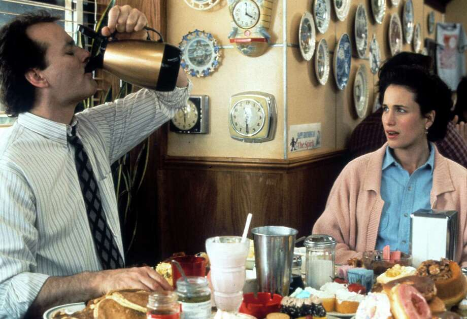 Bill Murray chugs a pitcher of coffee with Andie MacDowell in a scene from the 1993 film 'Groundhog Day.' This movie is good for a number of reasons, mainly for reminding us that, while we hate dealing with the arctic temperatures, at least we don't have to wake up and deal with them again, and again, and again, and again.... Photo: Archive Photos, Getty Images / 2012 Getty Images