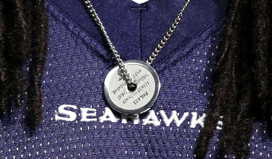 "Seattle Seahawks' Richard Sherman wears a biblical verse on a chain around his neck as he speaks at an NFL football news conference Wednesday, Jan. 22, 2014, in Renton, Wash. The verse is Philippians 4:13, reading ""I can do all things through Christ who strengthens me."" The Seahawks play the Denver Broncos in the Super Bowl on Feb. 2. (AP Photo/Elaine Thompson) Photo: Associated Press"