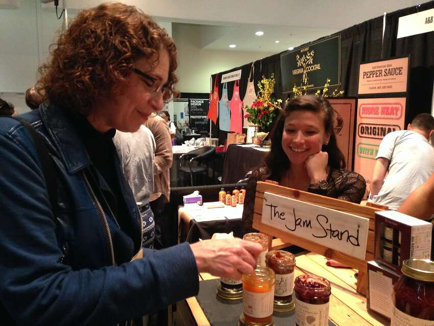 At the Winter Fancy Food Show, trend spotter Kara Nielsen tries Jam Stand's peach and sriracha jam.