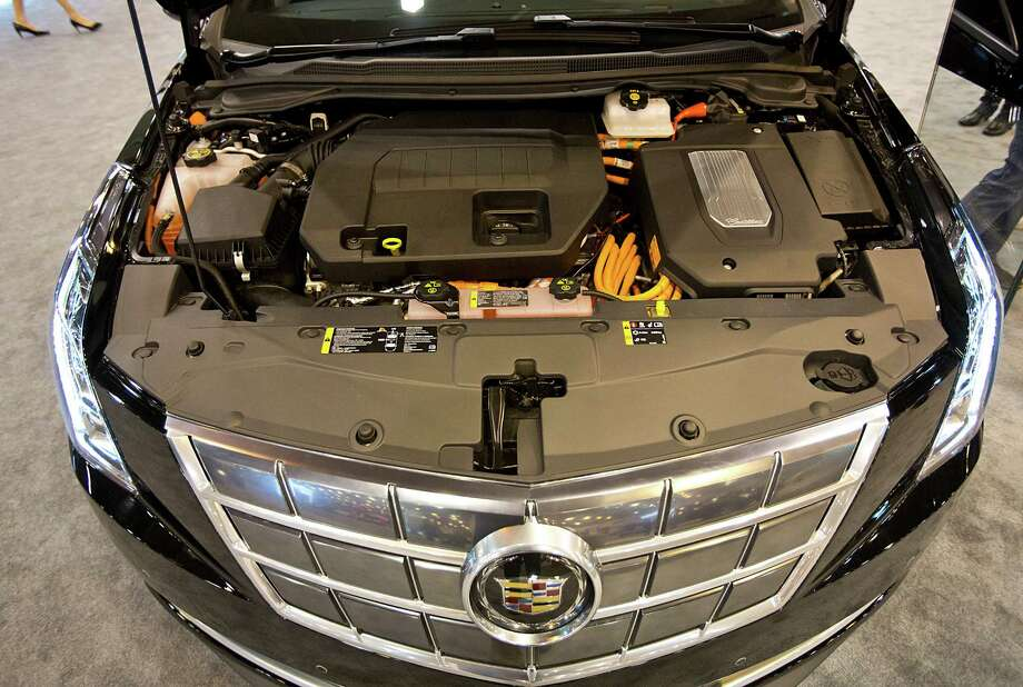 A look at the engine of  the fully electric Cadillac ELR at the Houston Auto Show. Photo: Thomas B. Shea, Houston Chroncile / © 2013 Thomas B. Shea