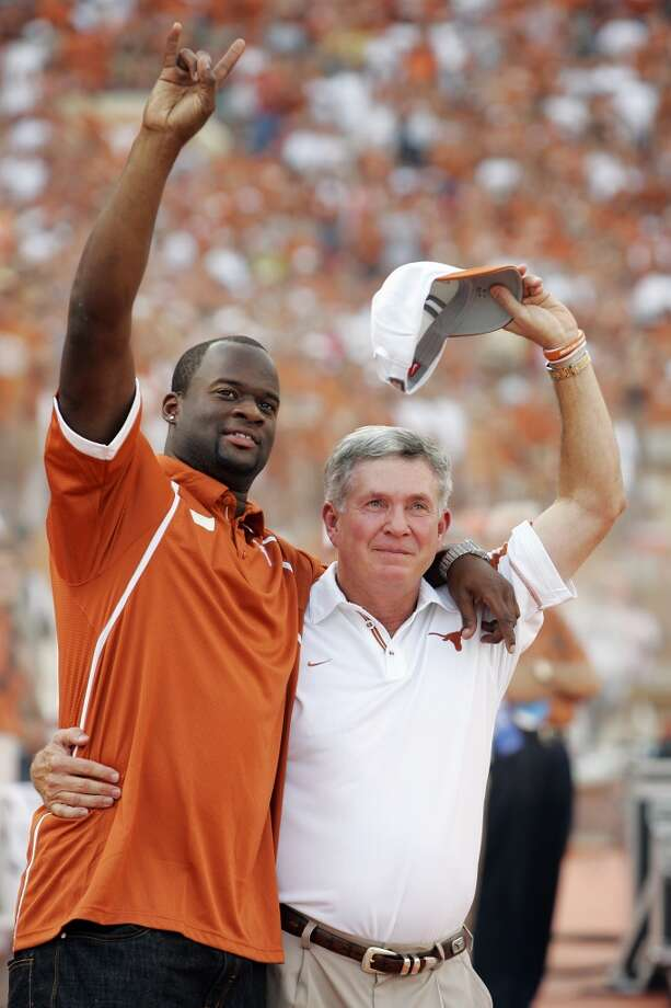 Vince Young with former Texas coach Mack Brown. Photo: Brian Bahr, Getty Images