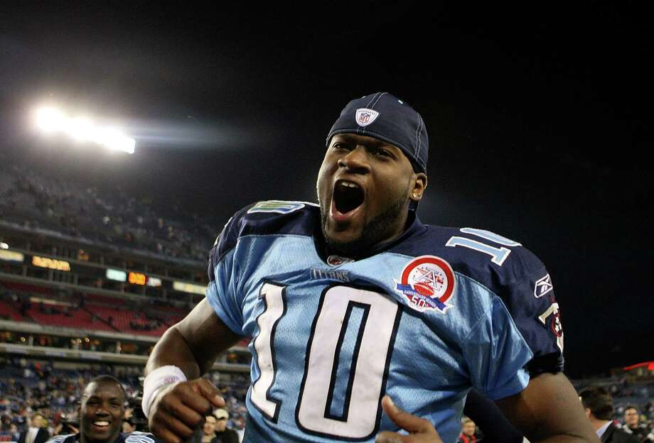 Tennessee Titans quarterback Vince Young celebrates a win in 2009, when he was on top of the world. Photo: Streeter Lecka, Staff / Getty Images North America