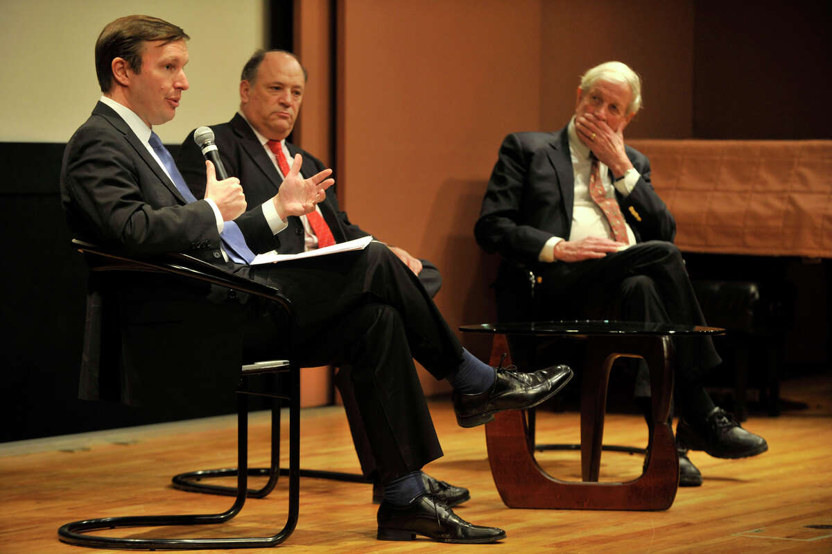 Sen. Chris Murphy, left, speaks as Robert Lesser, center, the president of the Jewish Federation Association of Connecticut, and William Luers, former ambassador to Venezuela and Czechoslovakia and current director of The Iran Project, listens during a town hall forum at the Greenwich Public Library in Greenwich, Conn., on Wednesday, Jan. 22, 2014, to discuss Iranian sanctions and and the current level of cooperation the country is giving with regards to halting their weapons-grade atomic program. Talk also revolved around a renewed call for sanctions during the current negotiating process.