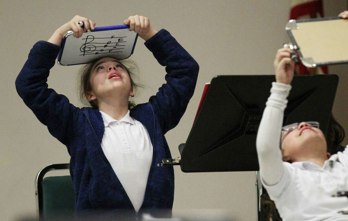 Elizabeth Berrones takes a look at her answer to a musical notes question during a music program by YOSA Mas at the Edgewood ISD Fine Arts Academy on Wednesday, Jan. 22, 2014. The school district is hoping to build up its music education with the addition of a new band hall and the addition of a new Steinway piano.