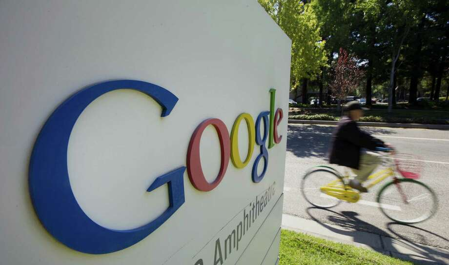A bicyclist rides his bike past a Google Inc. sign in front of the company's headquarters in Mountain View, Calif. Google has outspent its top five rivals combined as it moves into new markets beyond the Web. Photo: Bloomberg Photos / © 2013 Bloomberg Finance LP
