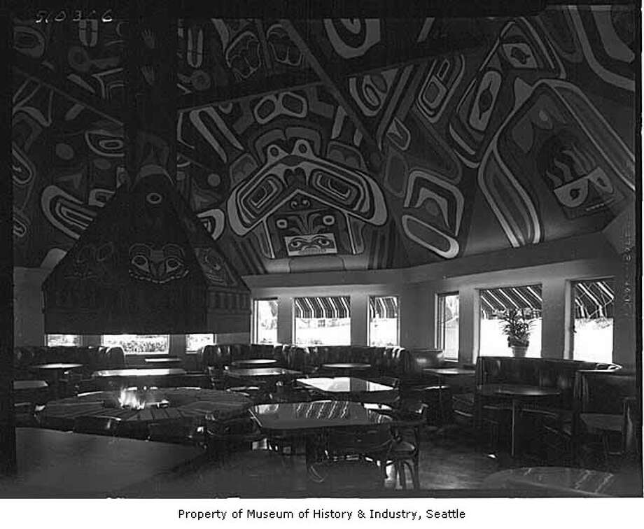 Hint for this photo: This restaurant with the Native American theme was popular when Highway 99 was the main freeway in Seattle.Photo: copyright MOHAI, Webster & Stevens, 1983.10.18141.2.