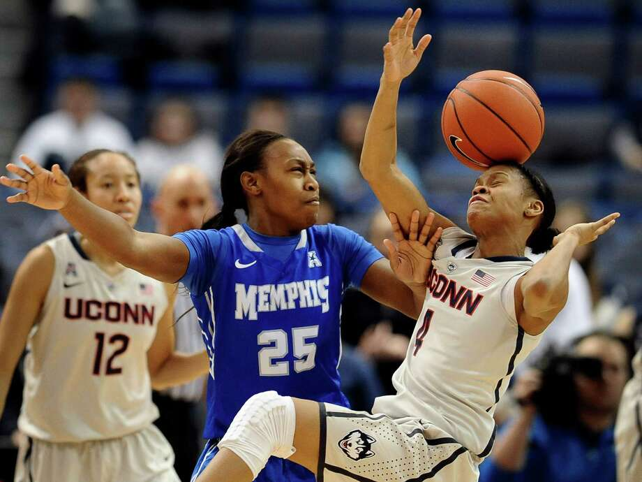 Memphis' Jasbriell Swain, left, and Connecticut's Moriah Jefferson, right, bobble the ball during the second half of an NCAA college basketball game, Wednesday, Jan. 22, 2014, in Hartford, Conn. Connecticut won 83-49. (AP Photo/Jessica Hill) Photo: Jessica Hill, Associated Press / Associated Press