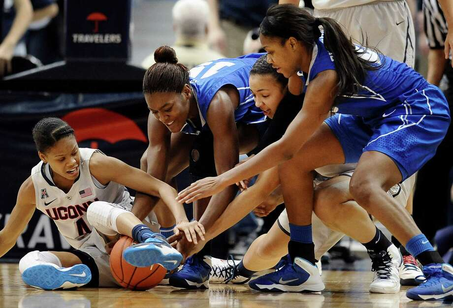 Connecticut's Moriah Jefferson, left, and Kiah Stokes, second from right, battle against Memphis' Asianna Fuqua-Bey, right, and Pa'Sonna Hope, second from left, for a loose ball during the second half of an NCAA college basketball game Wednesday, Jan. 22, 2014, in Hartford, Conn. Connecticut won 83-49. (AP Photo/Jessica Hill) Photo: Jessica Hill, Associated Press / Associated Press