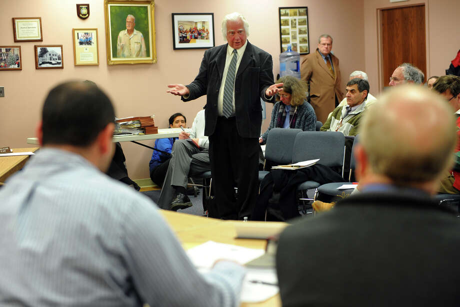 Arthur Bogan, with the Valley Regional Planning Agency, gives an assessment of the clean up of O'Sullivan Island during a Board of Alderman meeting in Derby City Hall in Derby, Conn. on Wednesday January 22, 2014. Photo: Christian Abraham / Connecticut Post
