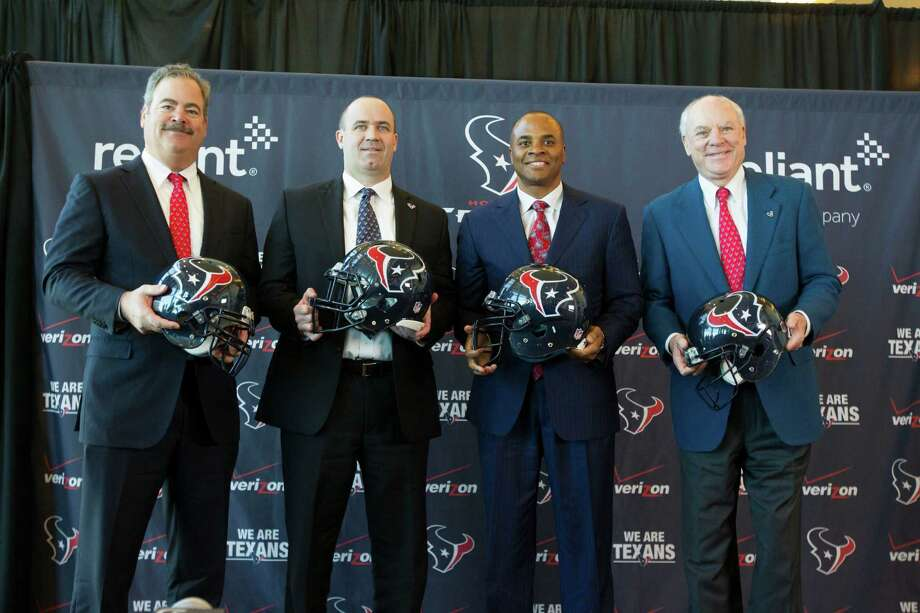 (From left to right) Houston Texans vice chairman and chief operating officer Cal McNair, head coach Bill O'Brien, general manager Rick Smith, and owner Bob McNair pose for a portrait during a press conference naming O'Brien the new Houston Texans head coach at Reliant Stadium, Friday, Jan. 3, 2014, in Houston. (AP Photo/Patric Schneider) Photo: Patric Schneider, FRE / FR170473 AP