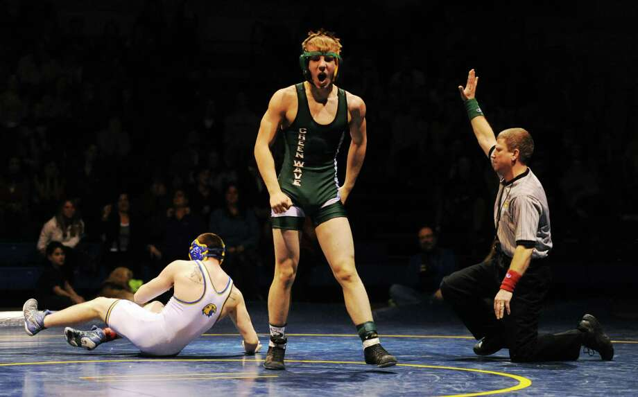 New Milford's Zach Arnold celebrates after pinning Newtown's Mike Long  in the 138 pound match during New Milford's 36-29 win over Newtown at Newtown High School in Newtown, Conn. on Wednesday, Jan. 22, 2014. Photo: Tyler Sizemore / The News-Times